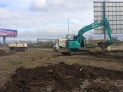 A photo showing dirt beginning to move at the site of the future Melbourne wind tunnel.