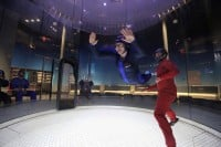 A woman enjoying her first flight at iFLY Kansas City.