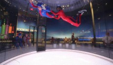 A first time flyer enjoys a high flight in this southern California wind tunnel.