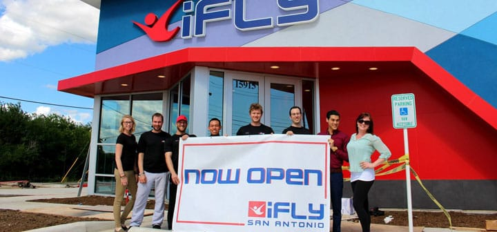 The Team out front of iFLY San Antonio with an Opening Banner
